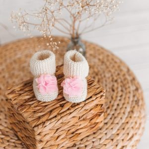 Crocheted woolen baby booties with decorations